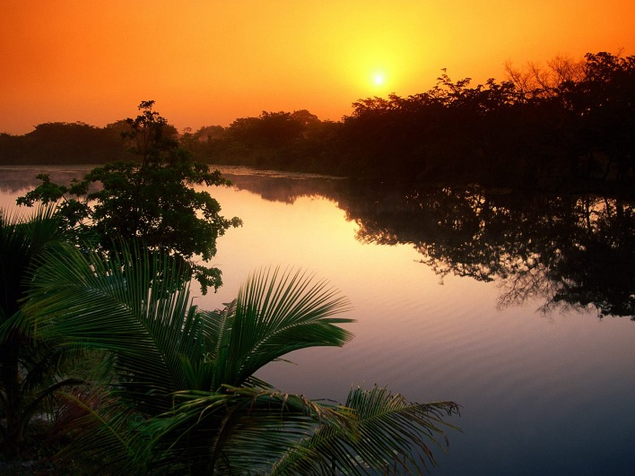Sun Rising Over the New River, Belize