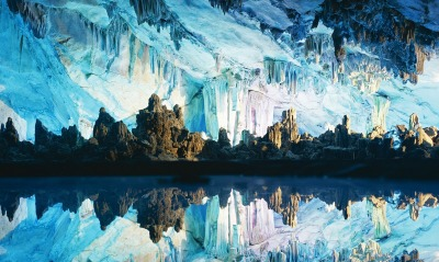 Stalactites and Stalagmites Reflected in Reed Flute Cave, Guilin, China